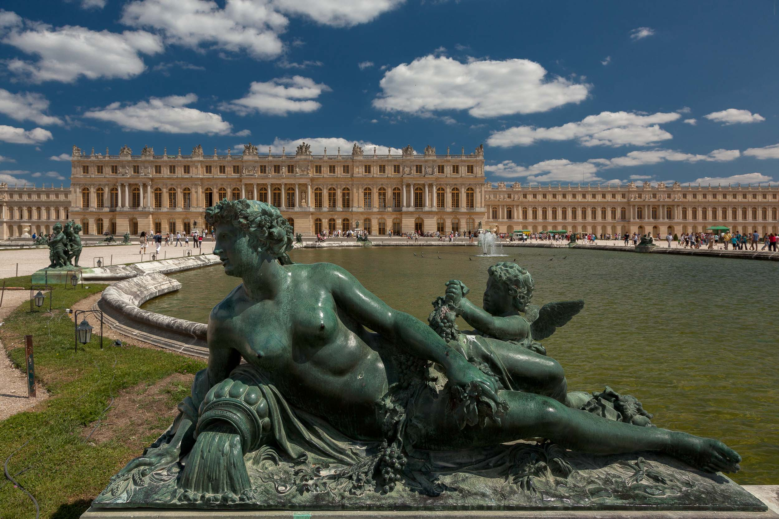 Statue   , depicted in a state of repose, in the grounds of    Versailles, France   .