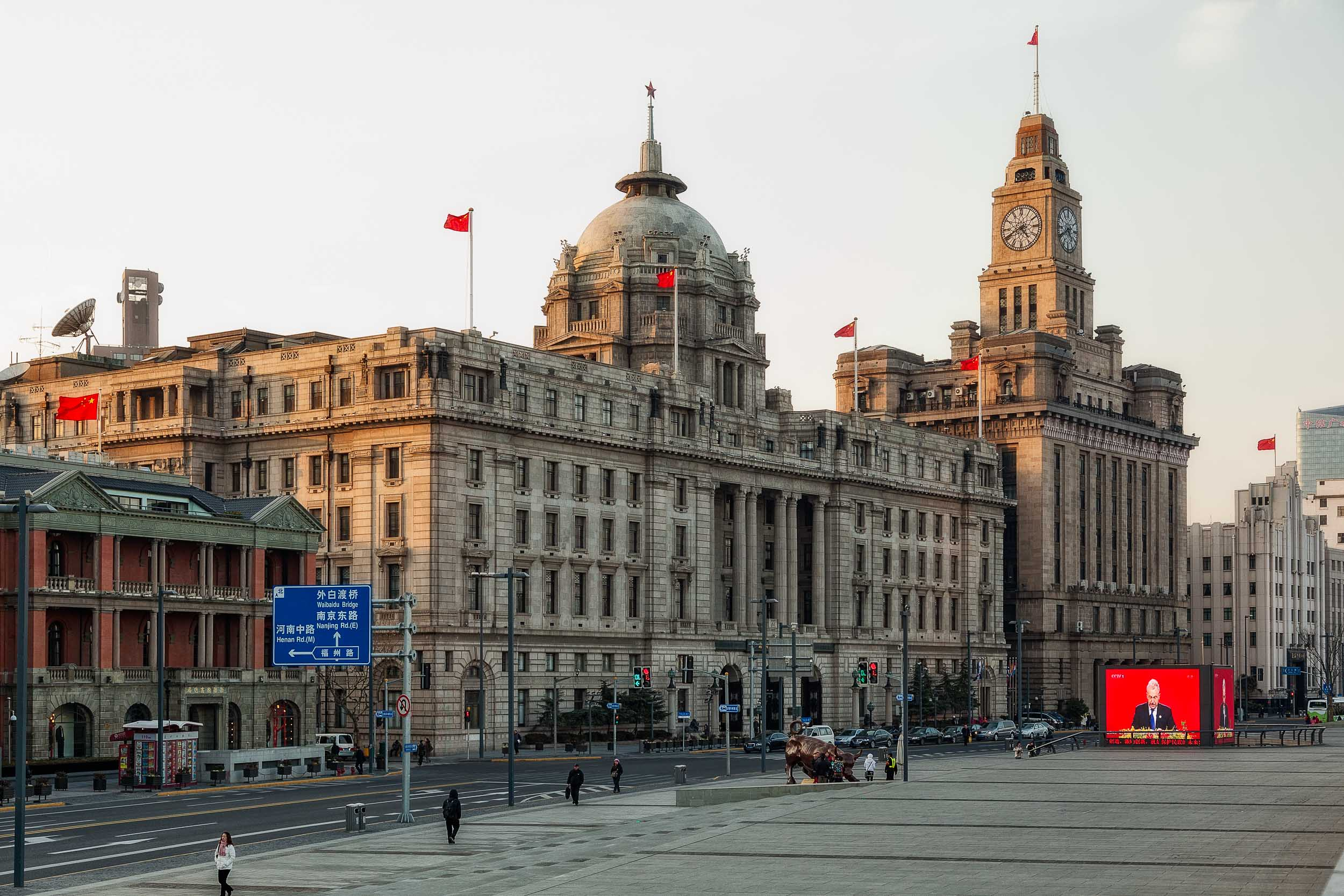 A view of    The Bund    near the corner of    Nanjing Road    in    Shanghai, China   .