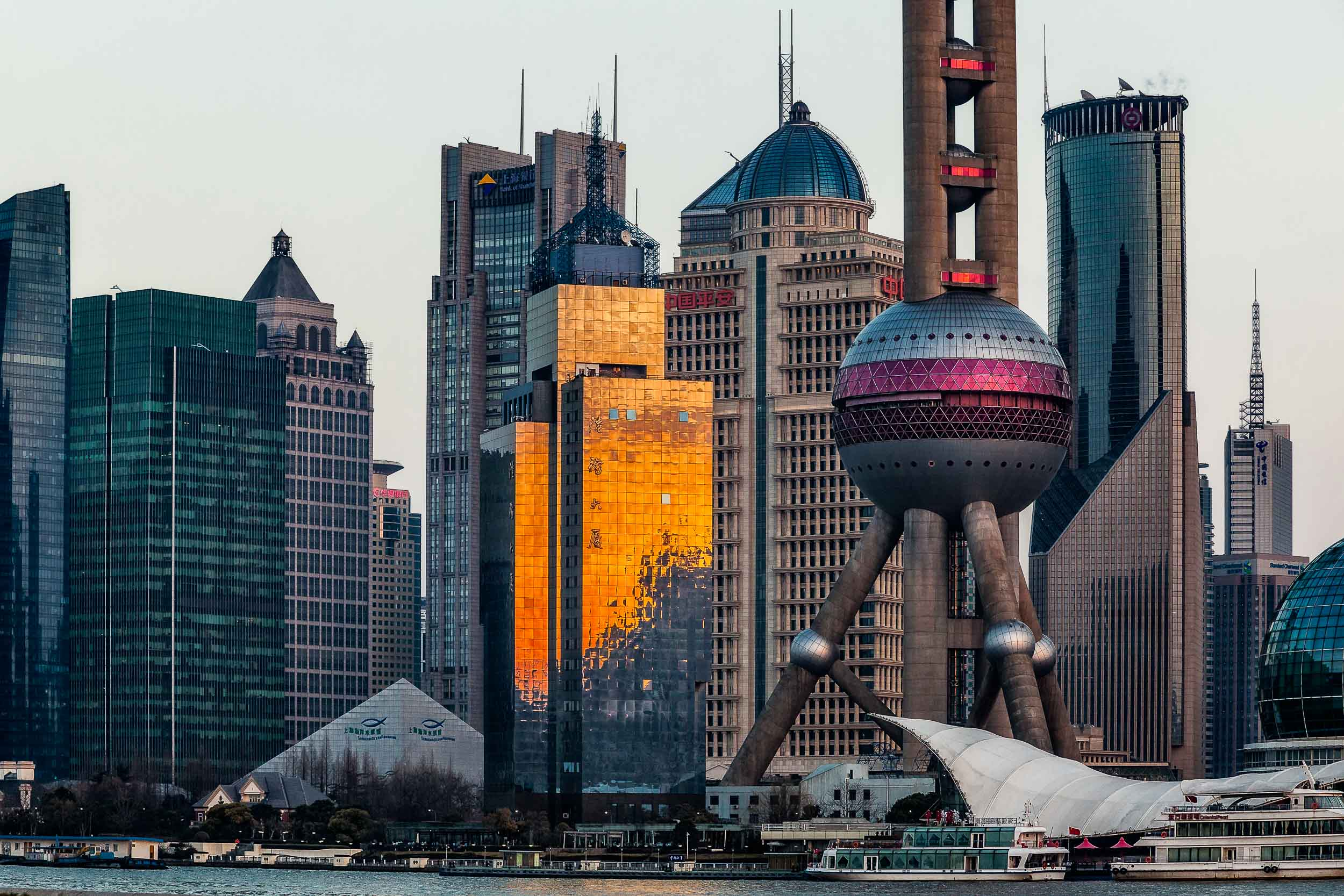 A view of    Pudong    from across the    Huangpu River    on The Bund in    Shanghai, China   .