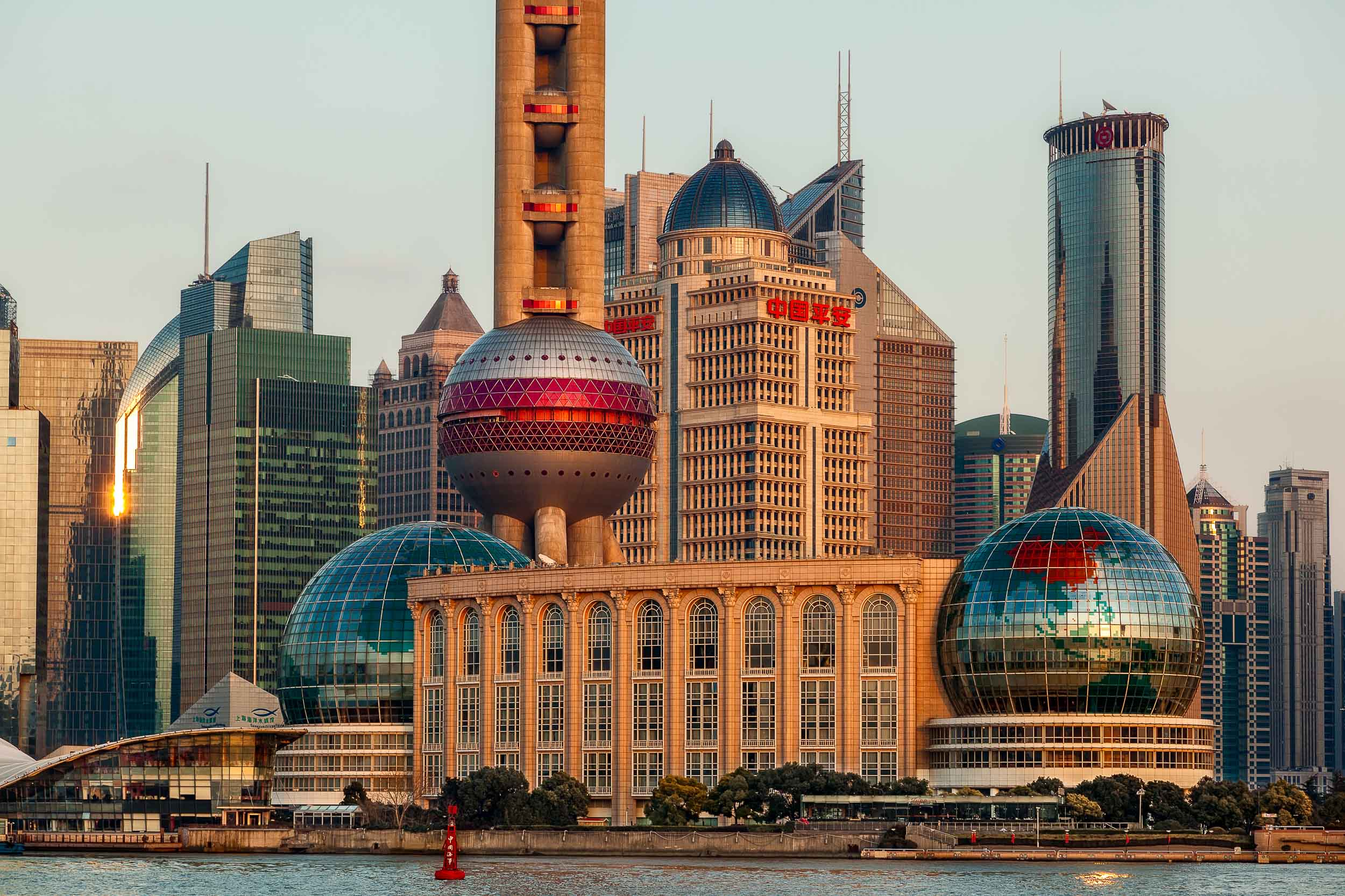 The futuristic skyline of    Pudong    in    Shanghai    illuminated at    sunset   .