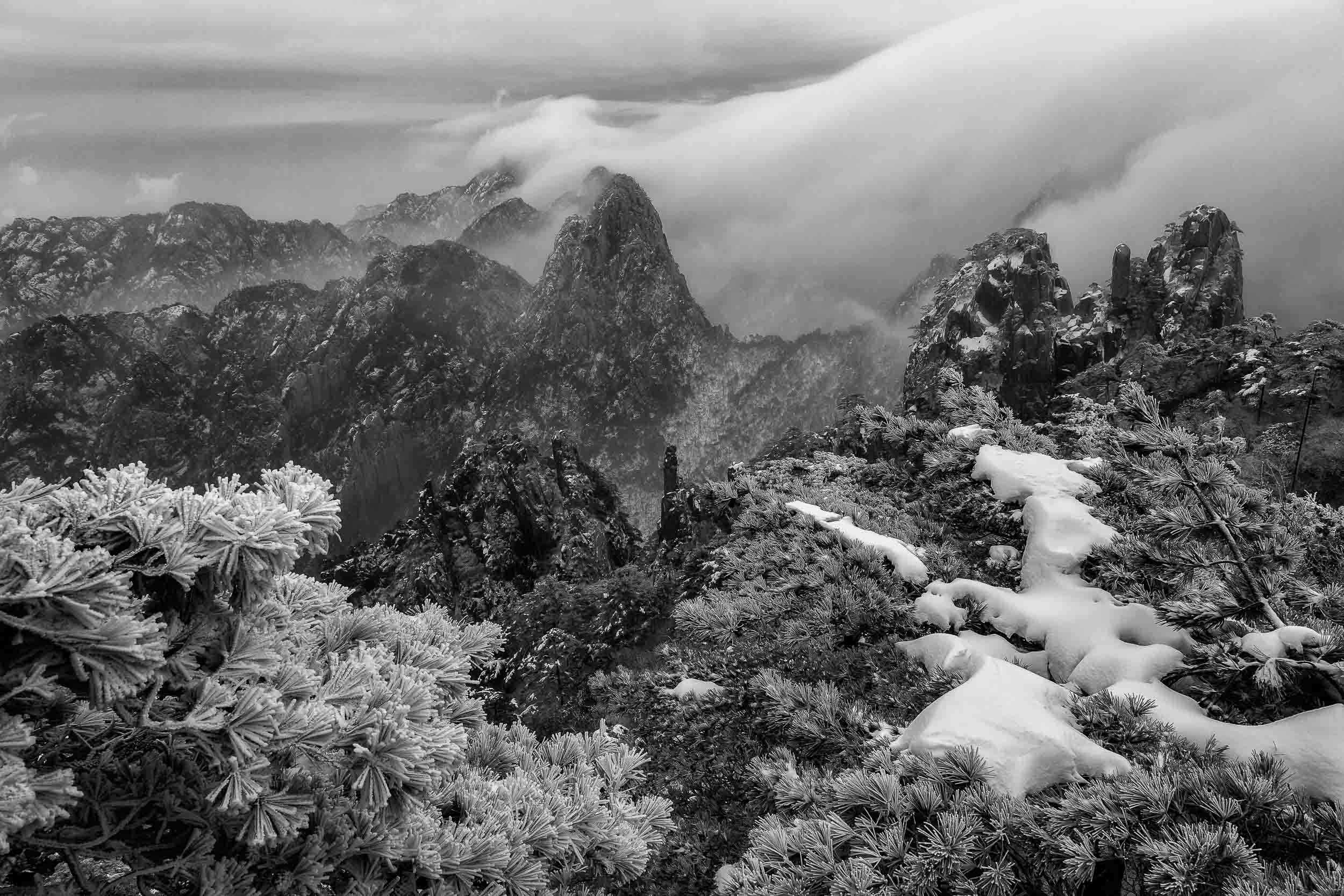 Clearing mist    reveals a spectacular landscape on    Huangshan    (i.e., Yellow Mountain) in    China   .