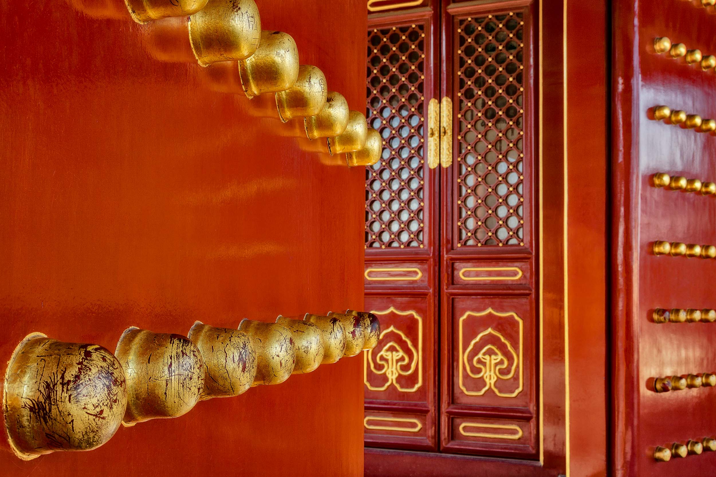 Large brass knobs and door at the Temple Of Heaven in Beijing.