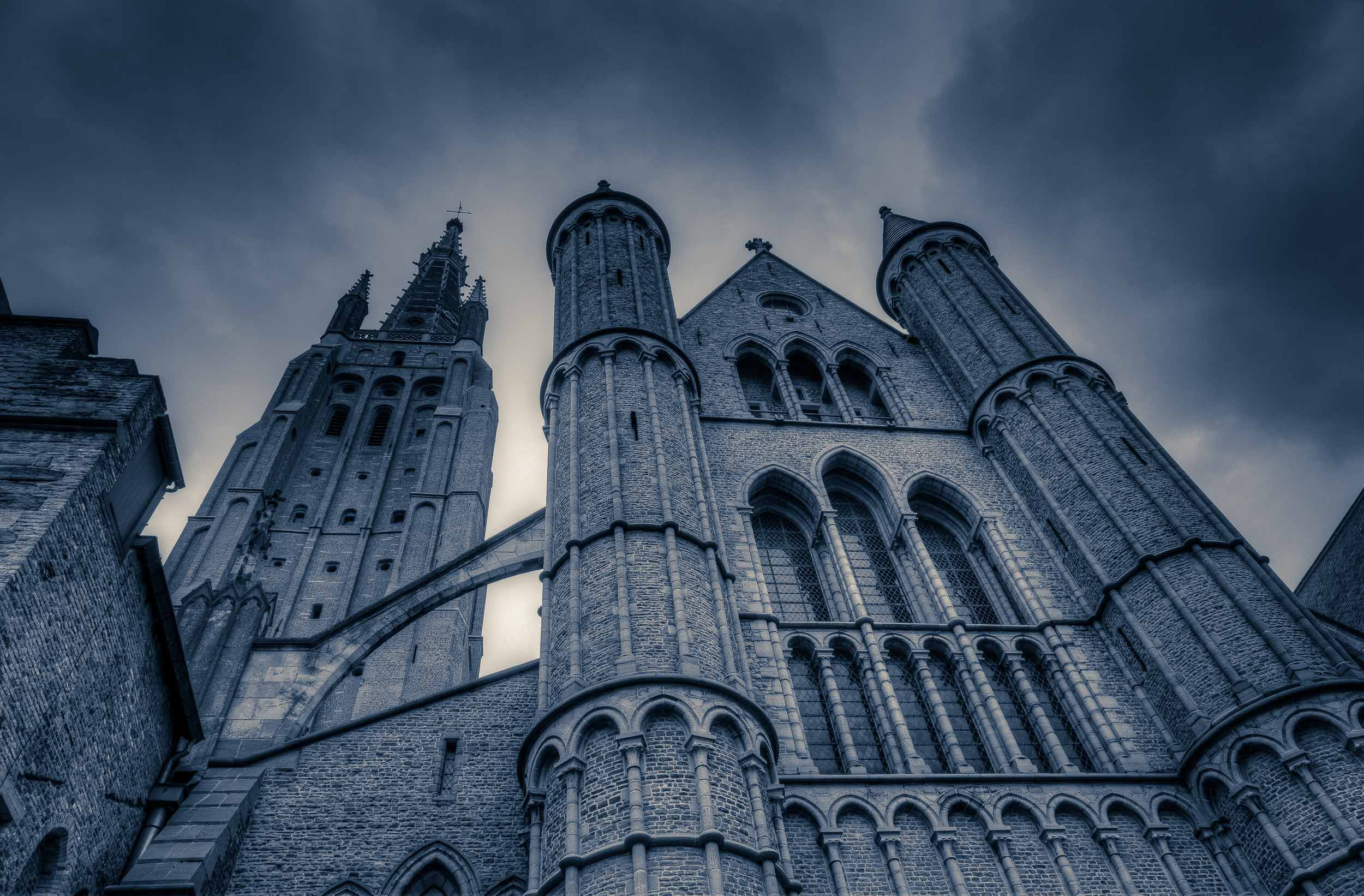 A dramatic exterior view of the    Church Of Our Lady    in    Bruges, Belgium   .