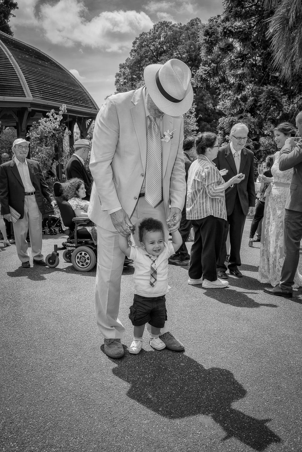 My friend    Ashley    and one of his grandchildren,    Adama   , enjoying the sunshine at his daughter Orely's wedding in the    Melbourne Botanical Gardens   .
