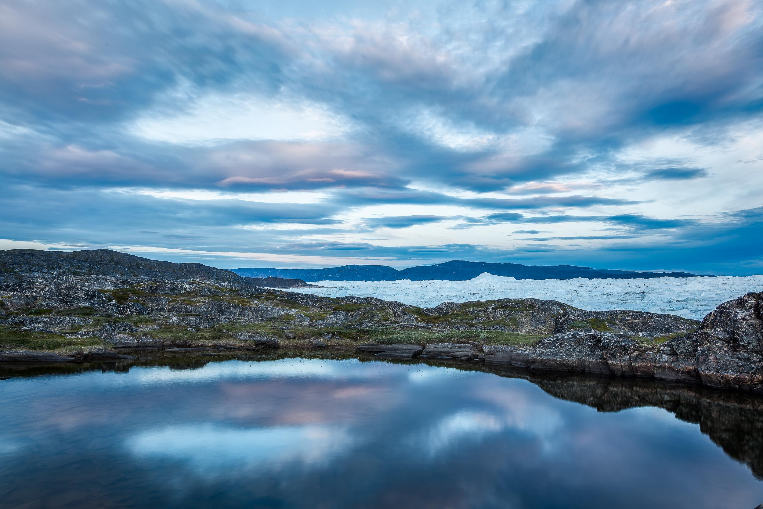 Safe waters    on the edge of the massive    Ilulissat Icefjord    in    Greenland   .