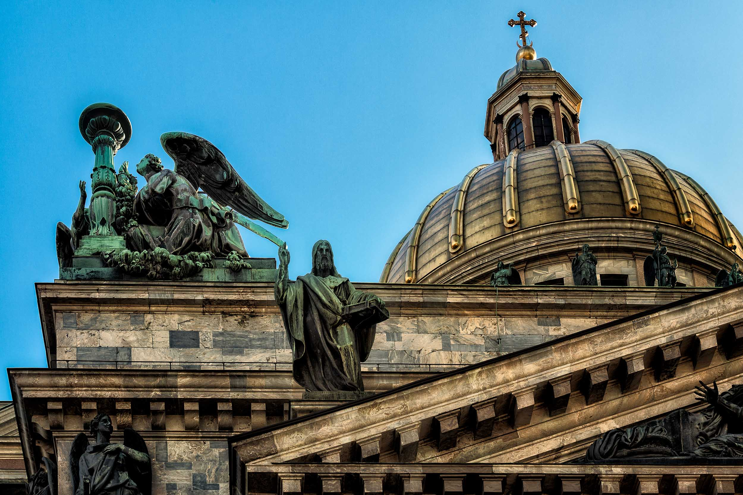 A dramatic view of the    dome and statues    at    St. Isaac's Cathedral    in    St. Petersburg, Russia   .
