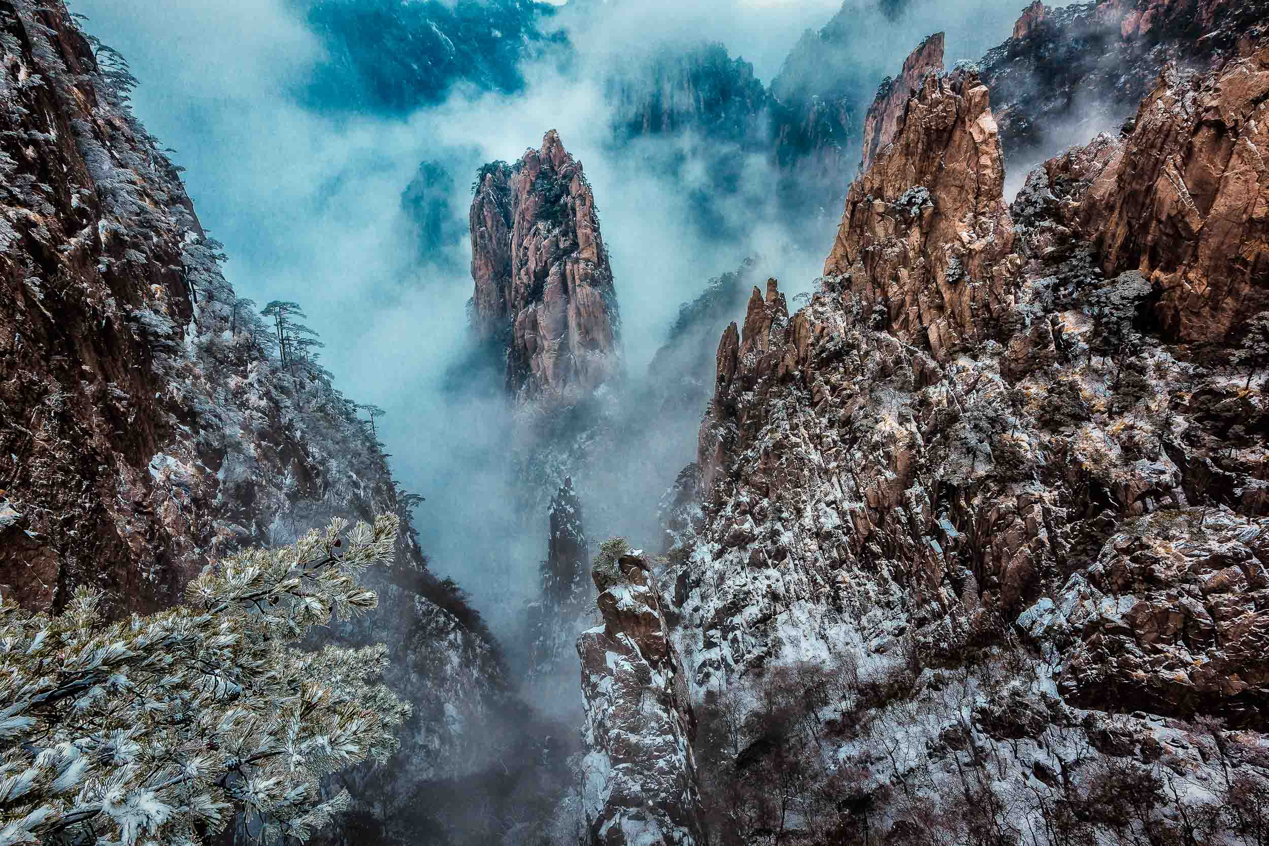 Mist swirling around peaks of stone on    Huangshan    (i.e., Yellow Mountain),    China   .