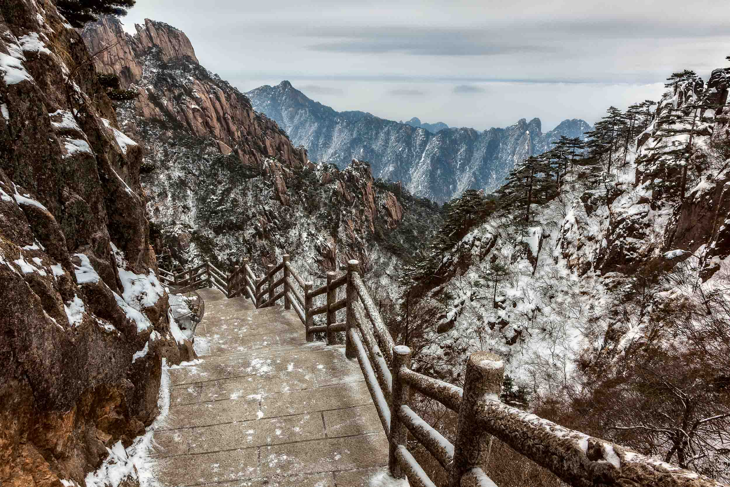 A  scattering of snow , on and around the mountain trail, on  Huangshan  (Yellow Mountain),  China .