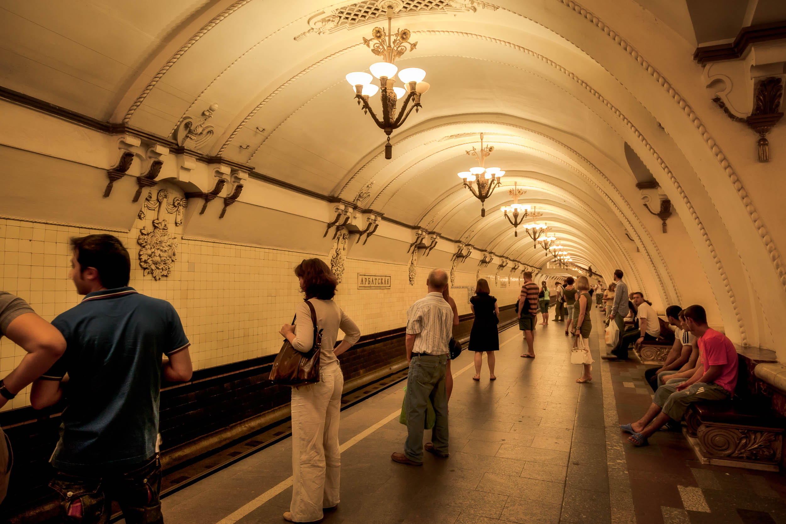 Commuters    waiting on the platform of an    underground railway station    in    Moscow, Russia   .