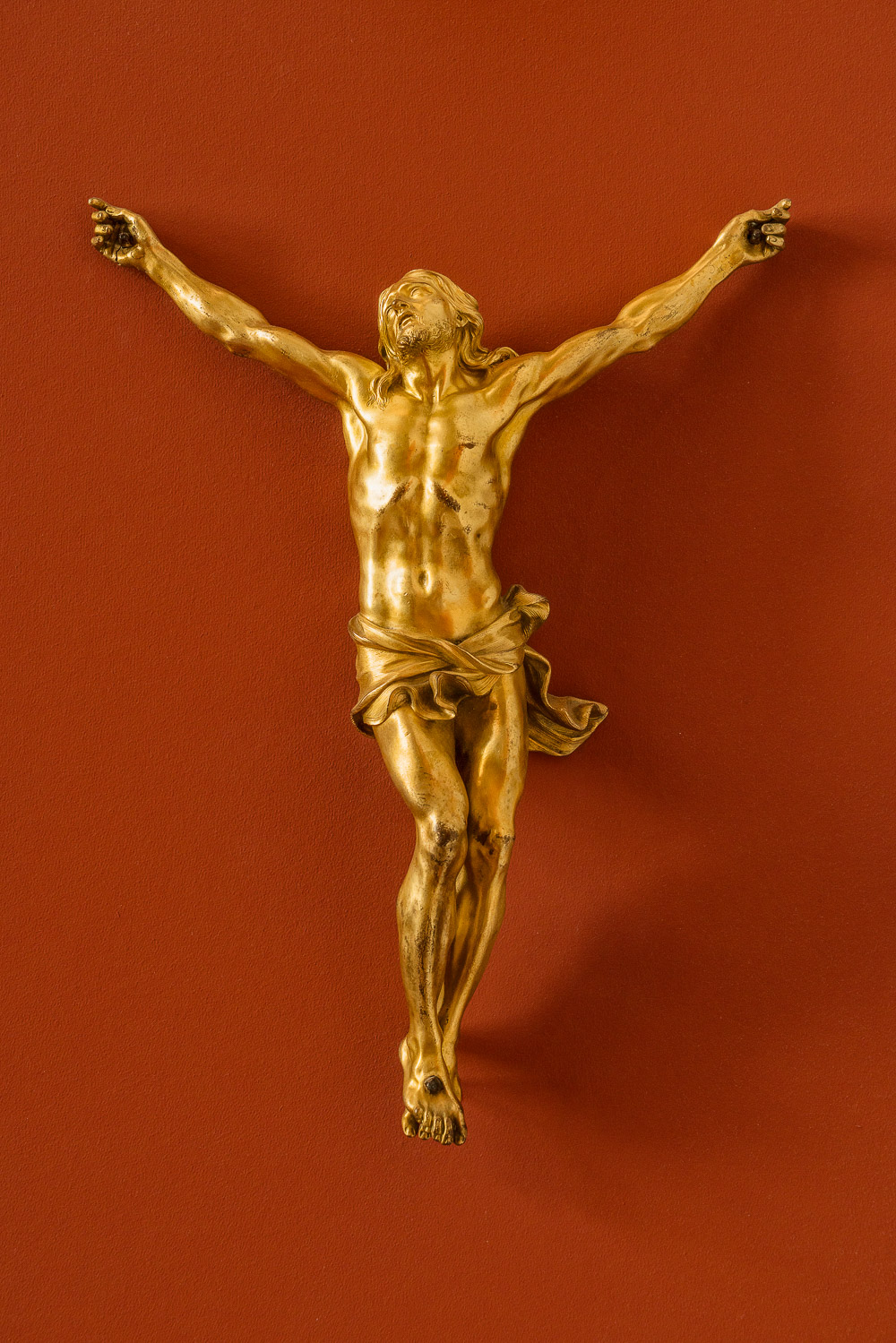 A beautiful and luminous    statue    of the    crucifixion    at the    Bode Museum    in    Berlin, Germany   .