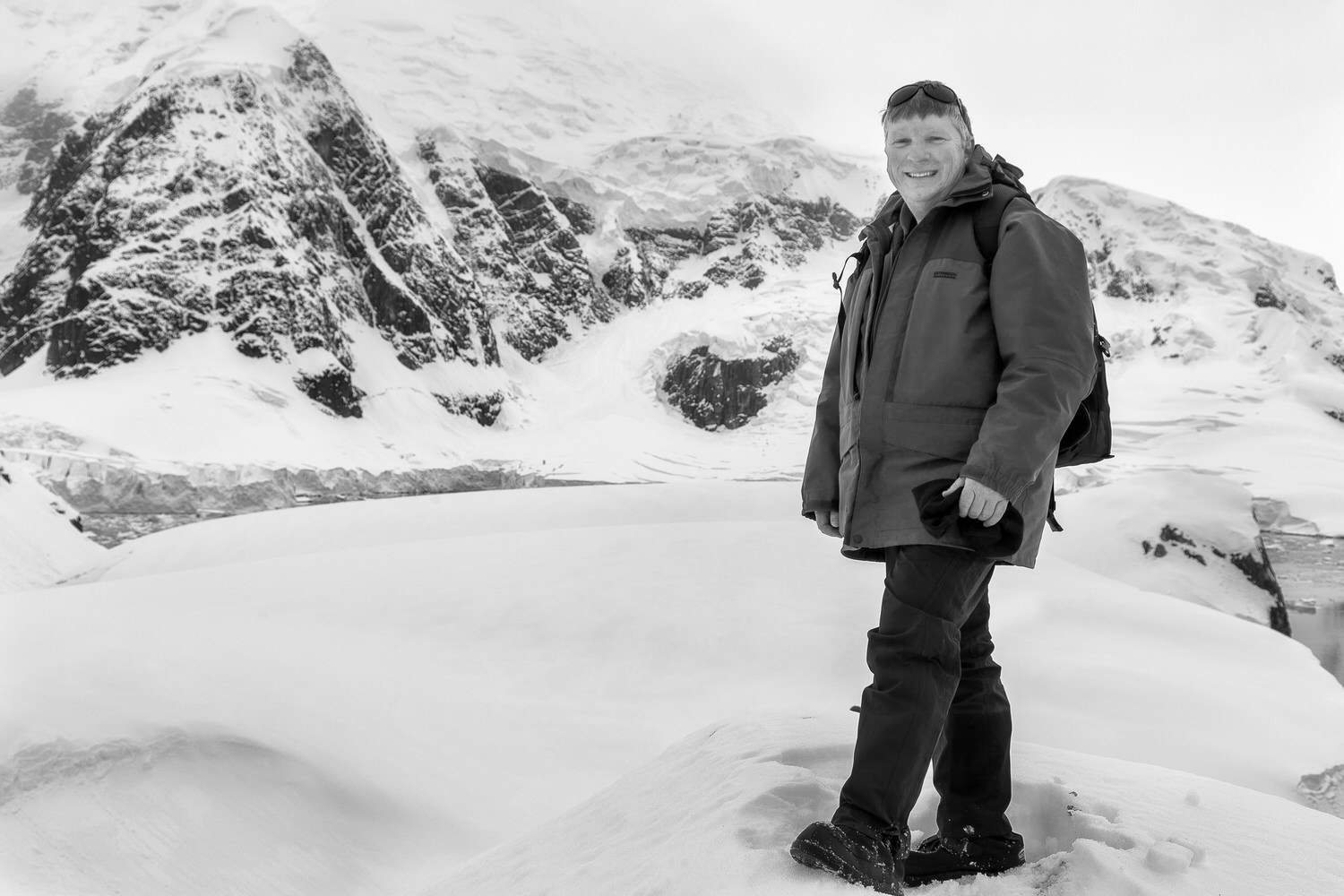 Glenn Guy   , the    Travel Photography Guru   , pictured high above the spectacular    Paradise Bay    in    Antarctica   .