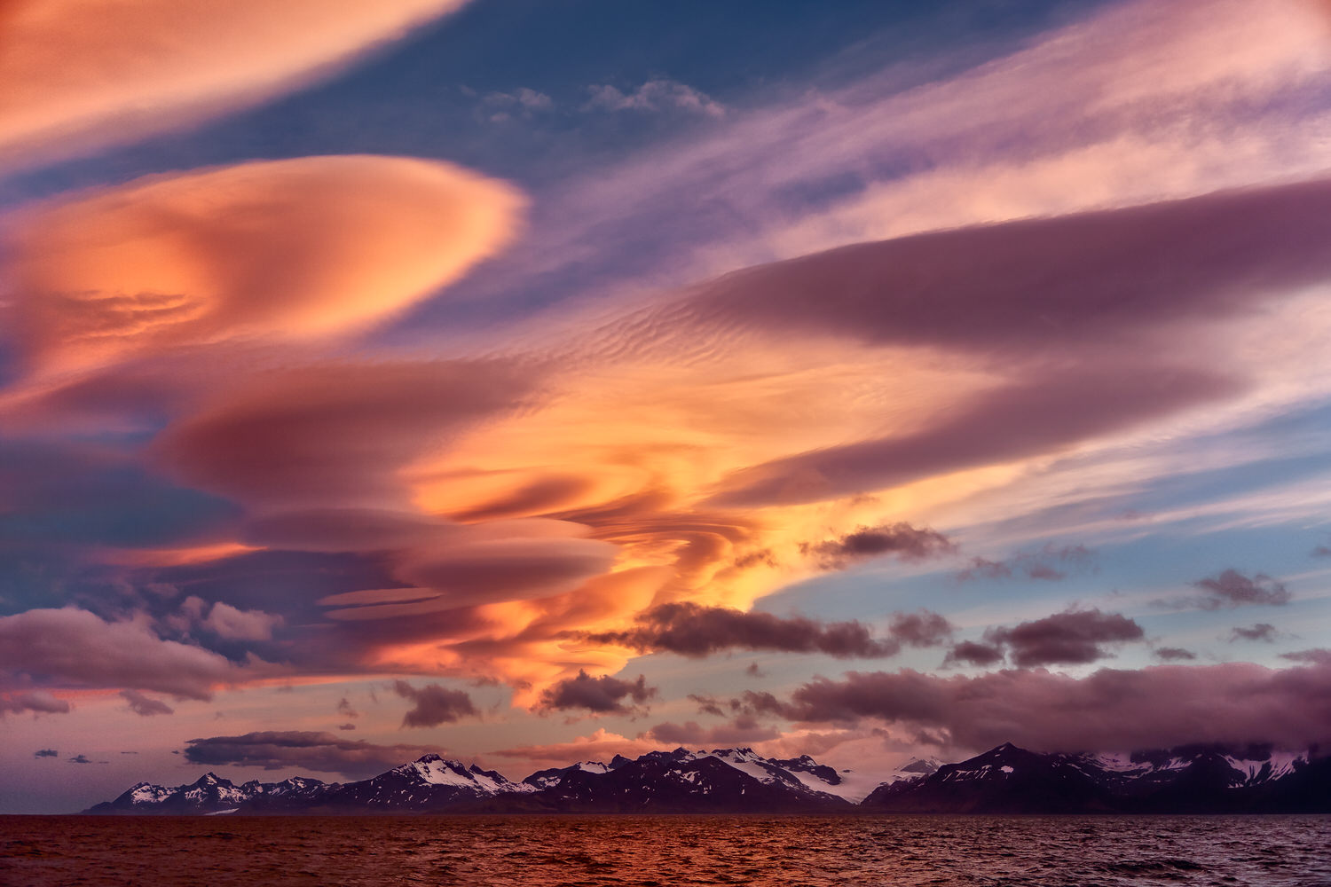 Spectacular    cloud formations    are illuminated by a    glorious sunset    over the    Beagle Channel    near    Ushuaia    in    Argentina   .
