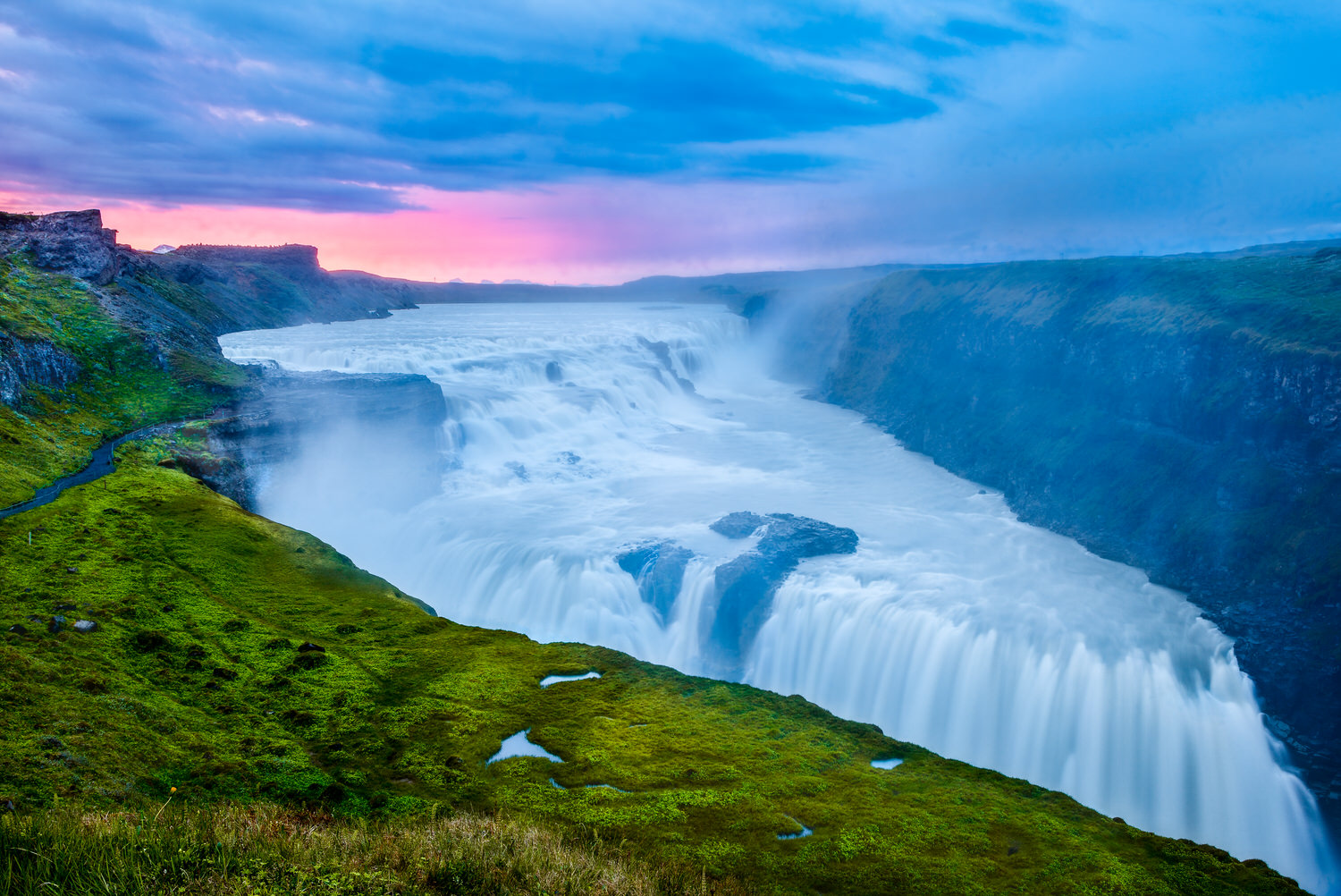 The spectacular    Gullfoss waterfall    in Southern Iceland photographed, through the mist, during the afterglow that followed a beautiful sunset.