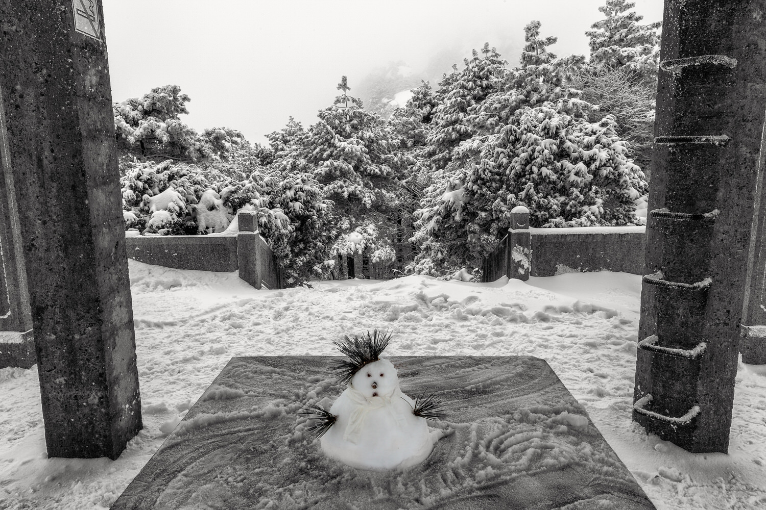 A    tiny snowman    under a shelter on    Huangshan    (i.e., Yellow Mountain),    China   .