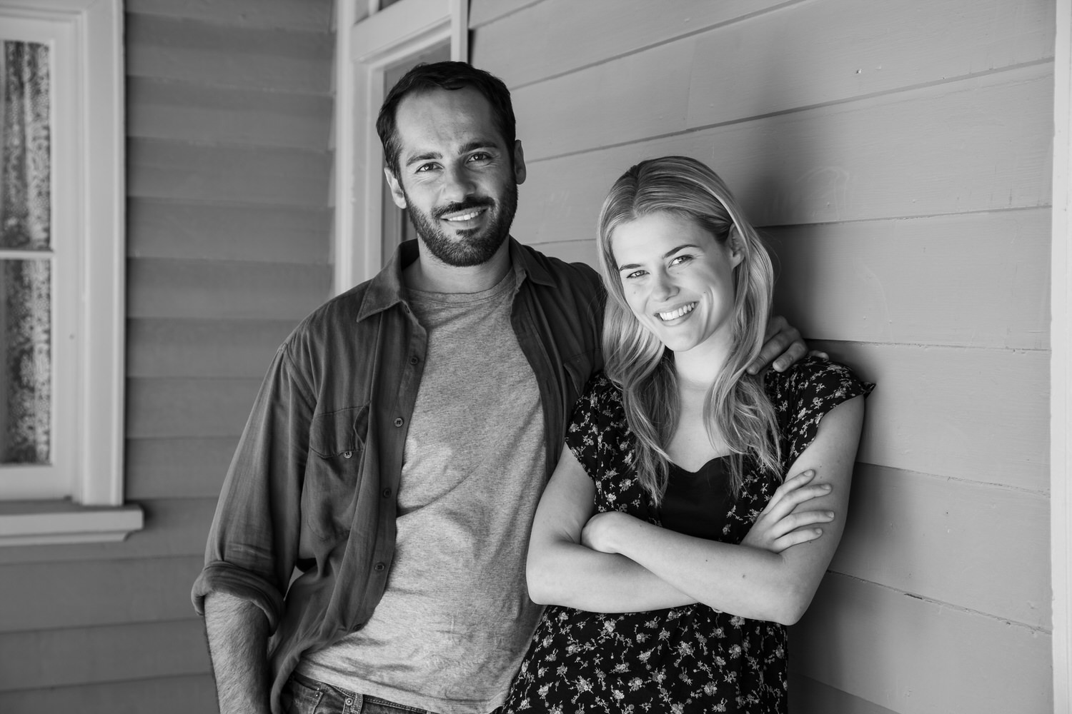 A black and white portrait of actors    Rachael Taylor    and    Alex Dimitriades    on the set of    Summer Coda    in Mildura, Australia.