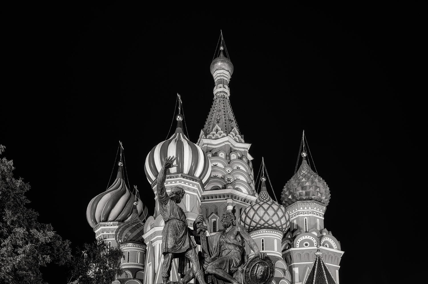 Statue of two heroes,    Minin and Prince Pozharsky   , in front of    St. Basil's Cathedral    at night in    Moscow, Russia.