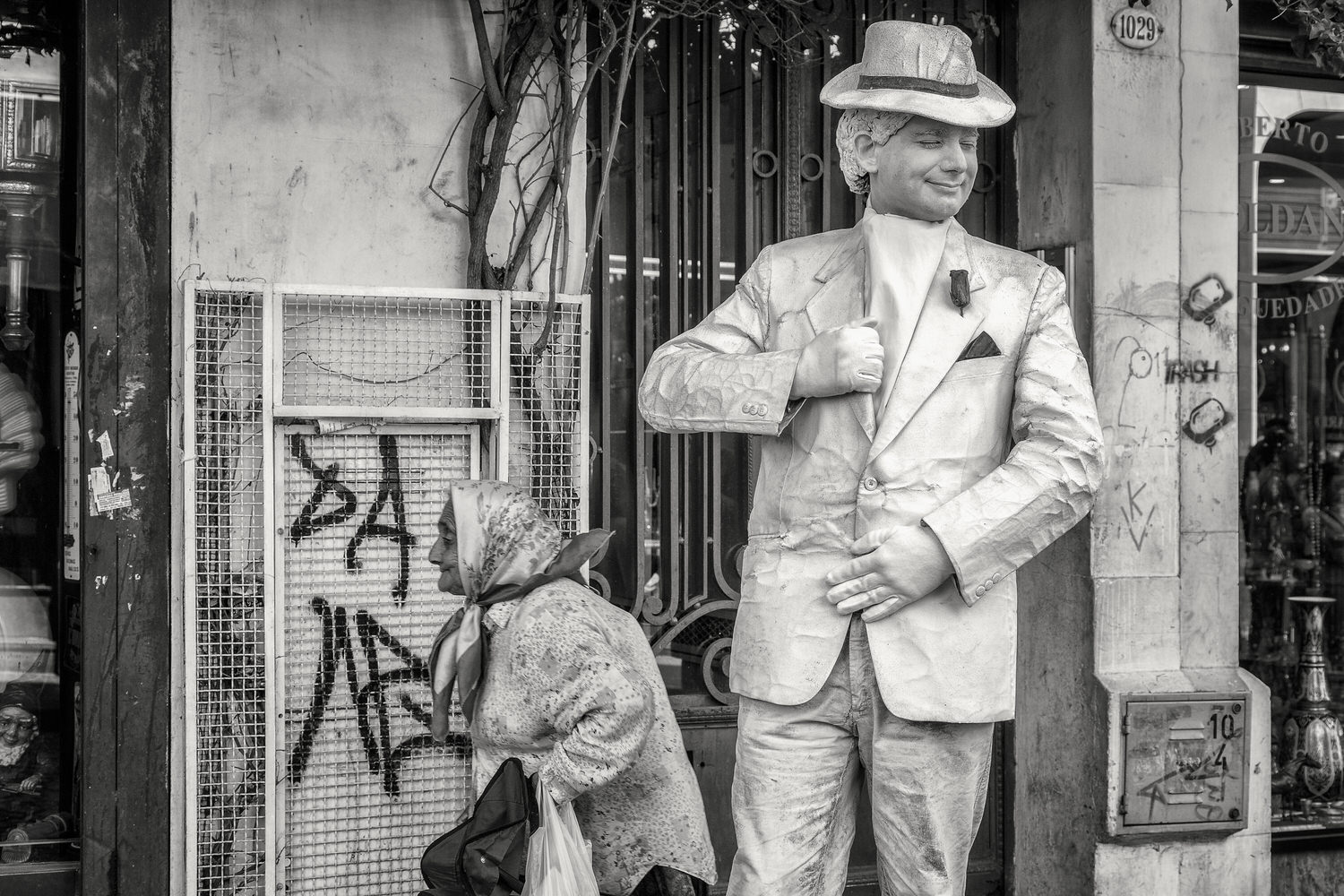 A classic street scene featuring a    street performer    and an elderly passerby in the    San Telmo    neighbourhood of    Buenos Aires, Argentina   . Black and white photography is the great equaliser, often removing the subject/s from a particular time and place.