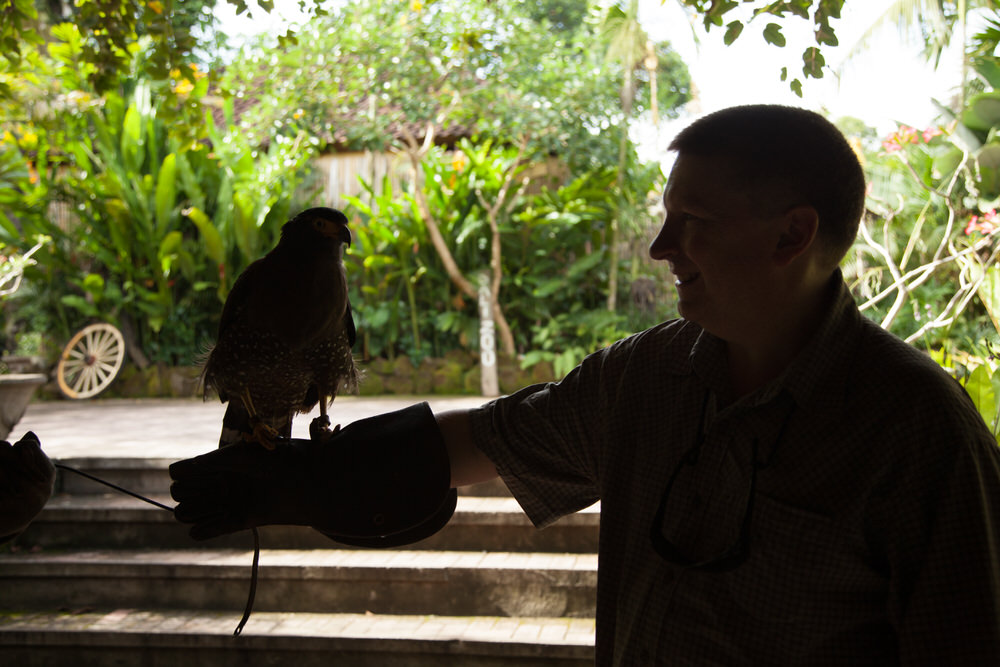 Backlighting    has produced a    technically poor quality photo    of Glenn Guy in silhouette at the    Bali Zoo    in Bali, Indonesia.