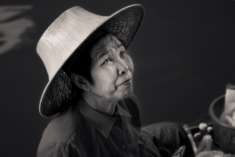 An  elderly woman , displaying a trusting expression, at the  Damnoen Saduak Floating Markets  near  Bangkok, Thailand .