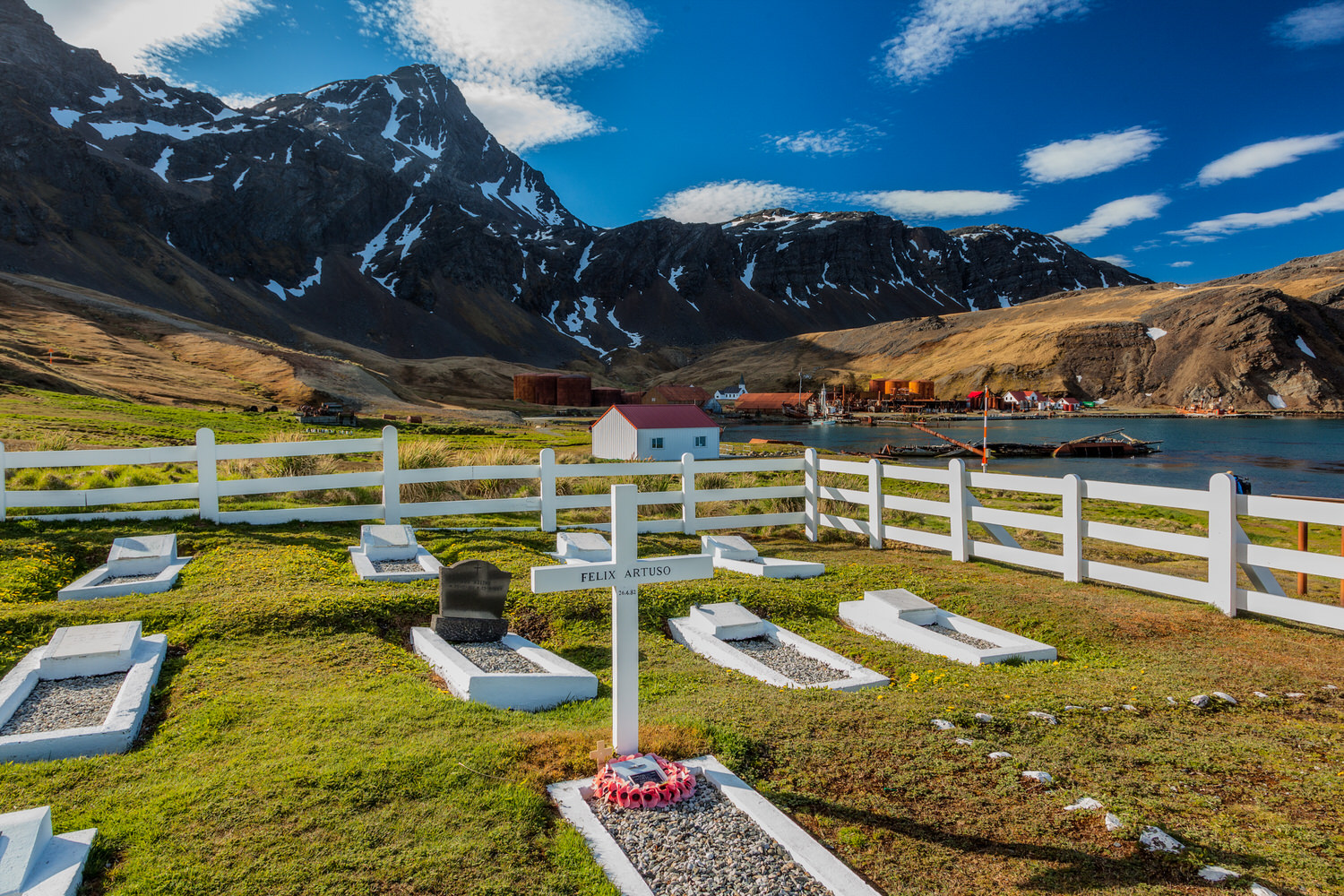 The grave of    Felix Artuso    set amongst the dramatic landscape surrounding the    old whaling station    at    Grytviken    on    South Georgia Island   .