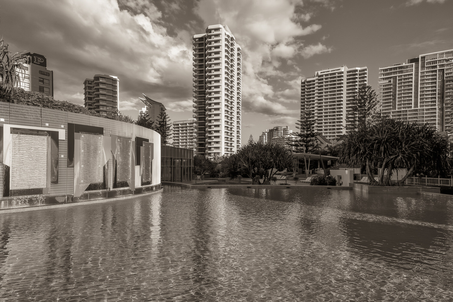 A warm tone black and white view of the    swimming pool    and surrounding high-rise buildings at the    Q1 Resort and Spa    in Surfers Paradise on Australia's    Gold Coast   .
