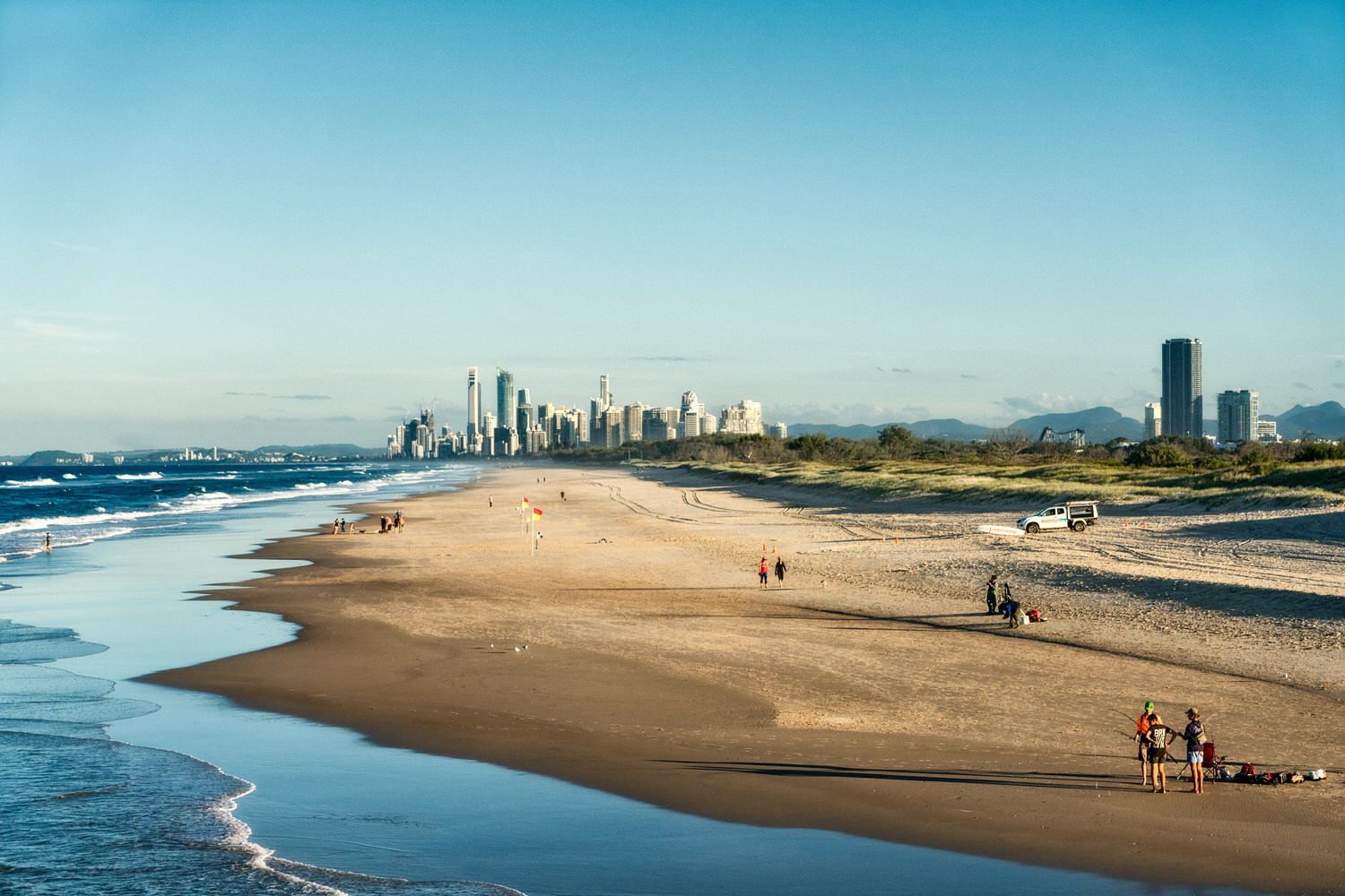 Walking along the    dog friendly beach    at The Spit on Australia's    Gold Coast   .