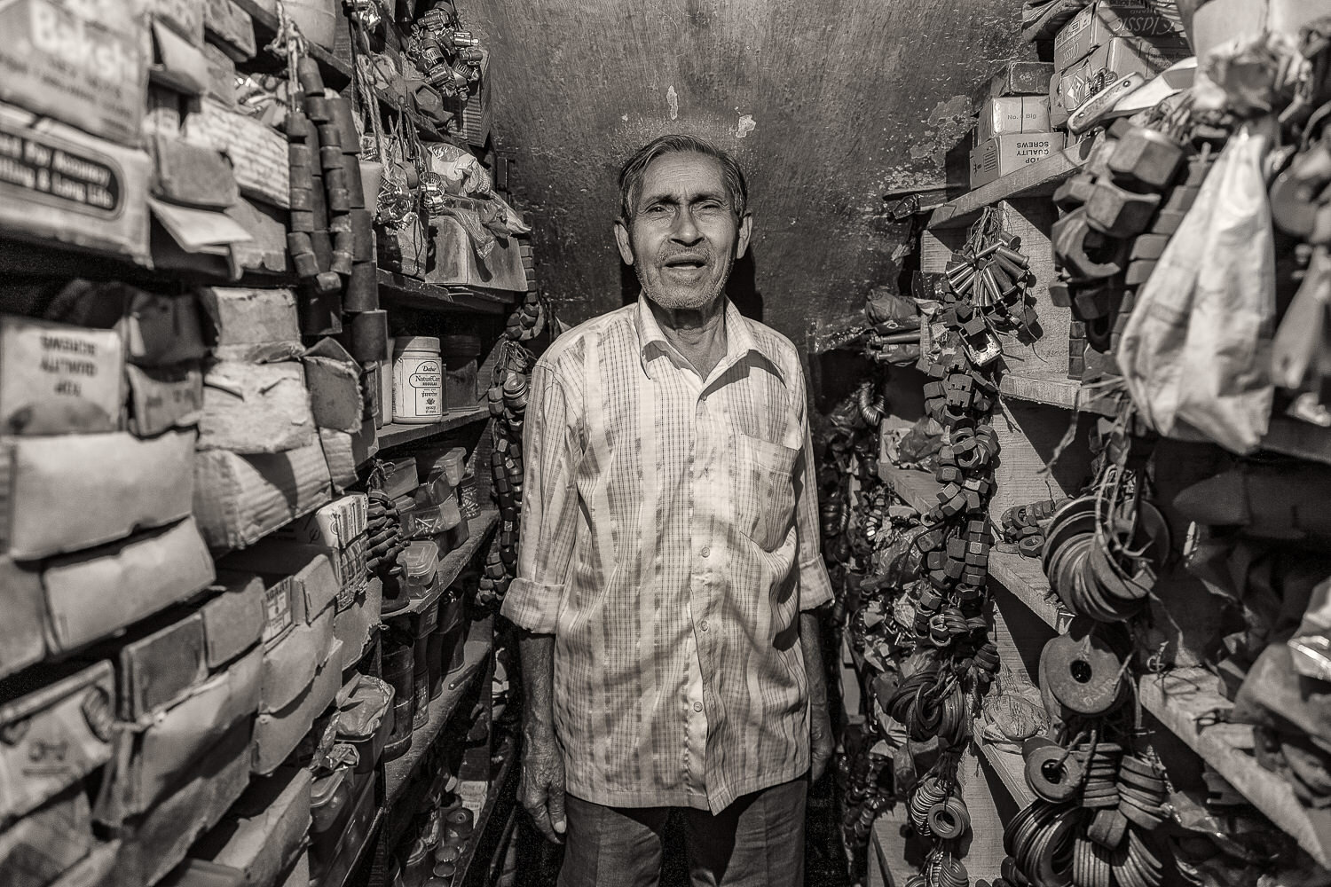A man in his    spare parts store    in the backstreets of    Kolkata   , India.