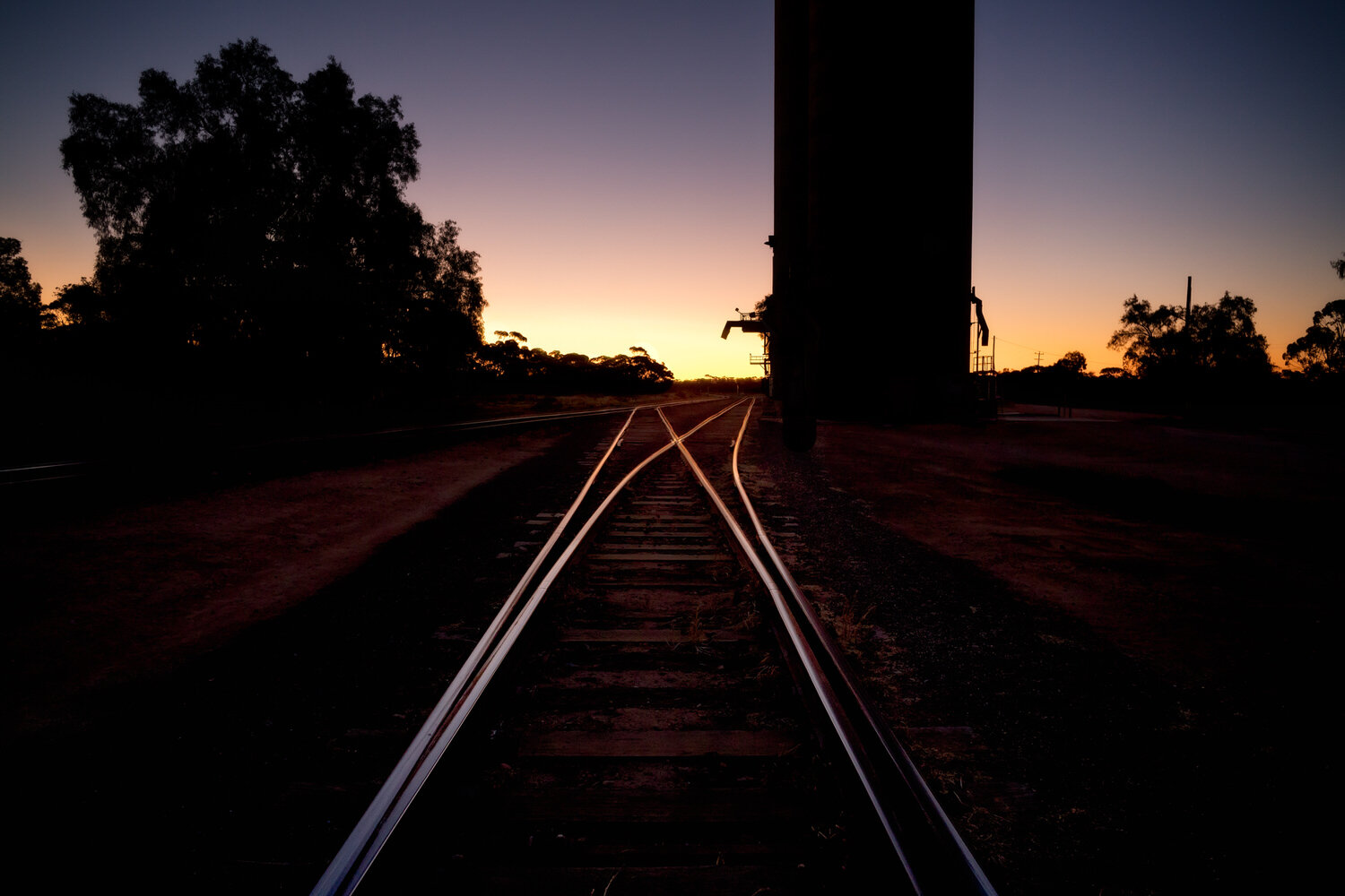 Linear perspective leading to a vanishing point on railway tracks at Murrayville.