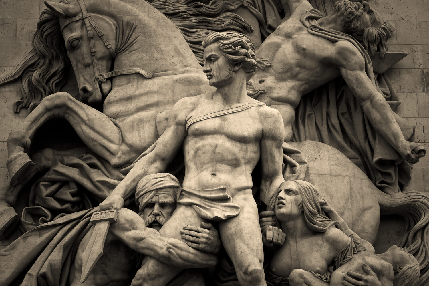 Heroic composition constructed around circles and triangles at the Arc de Triomphe.
