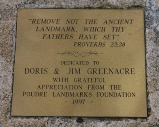 a closeup of the plaque on the bench