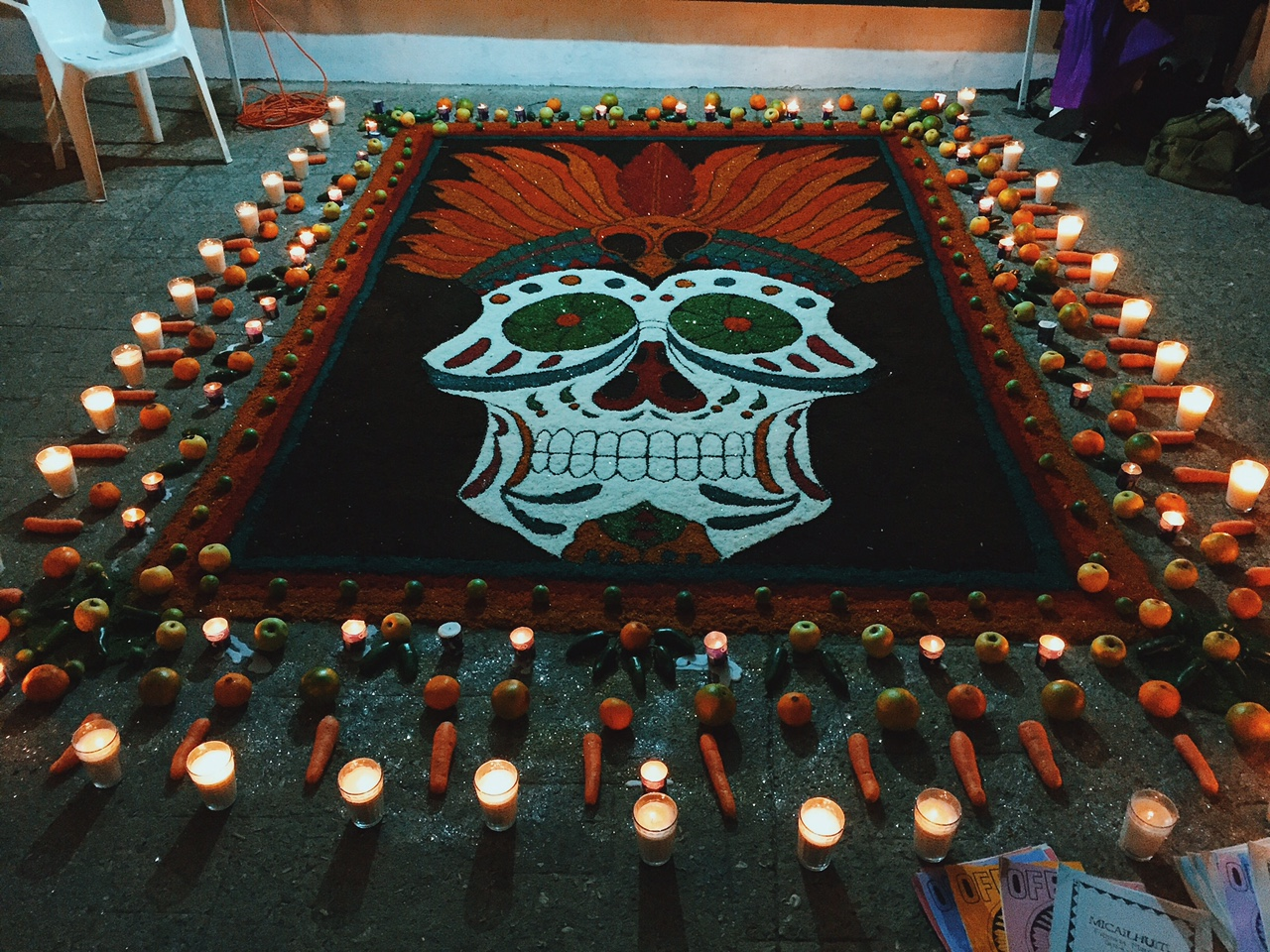 One of the many alters around town, created by hand over days and made with colored sawdust, candles and fresh veggies