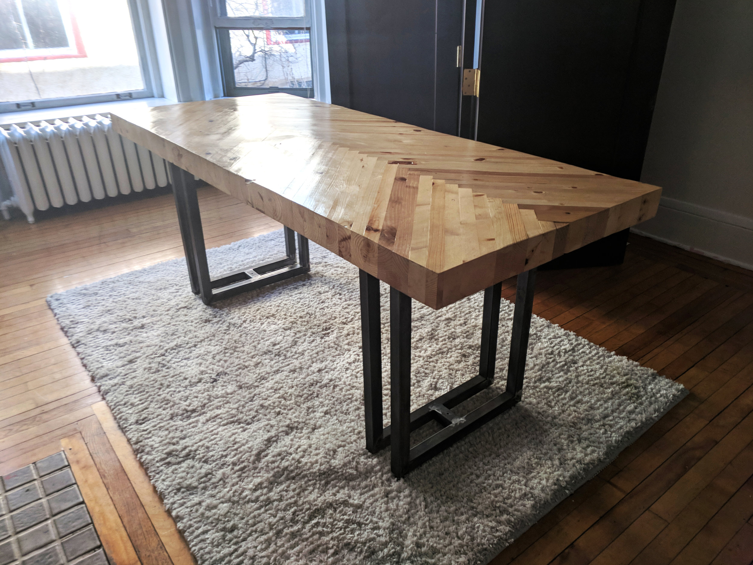 "Dining table, commission.  Detail.  6'6"" x 2'4"" x 1'8"".  Reclaimed pine and steel.  2016.   © Theresa Akers. Photo by Justin Sims. All rights reserved."