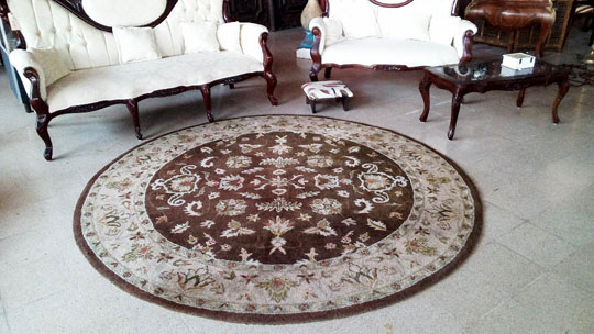Round wool rug -7 1/2 ft diameter.Was $250