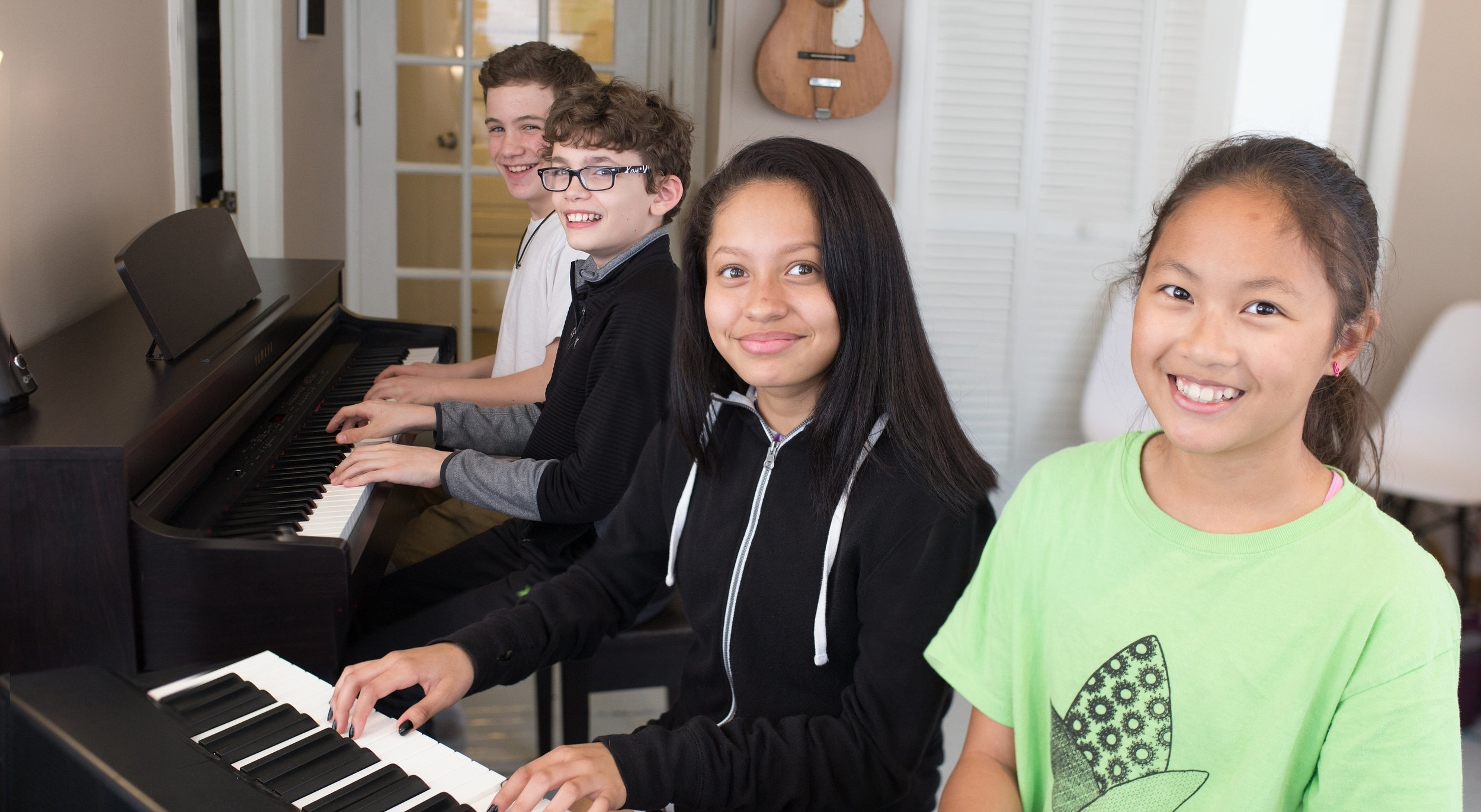 teen group playing piano