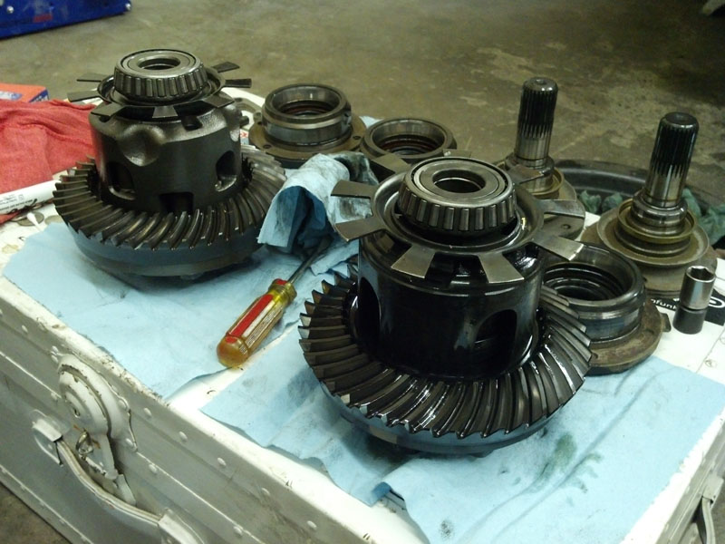 The two differentials out of the case swapping speedometer wheels. On the left, the 3.91 Torsen unit and on the right the stock 3.23 clutch pack unit.