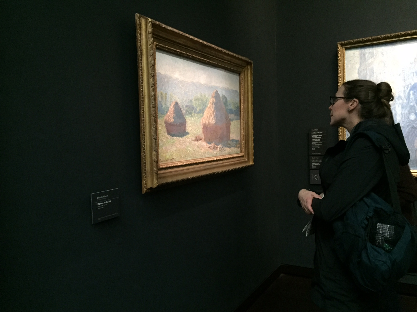 I had the opportunity to see a few of these haystack paintings at the  Orsay  in Paris a couple of years ago. They were stunning and I was oblivious to everything else, including this photo being taken!