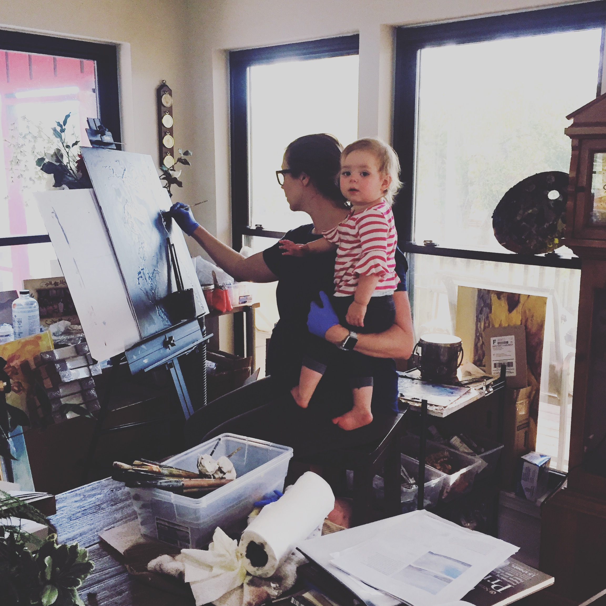 """Once construction really got going, I moved my """"studio"""" back upstairs to our dining room, which is where I finished the  Twisted Compass collection . Believe it or not, I actually really enjoyed painting right in the middle of life (Just not the mess it made). 30 weeks pregnant, working on """" Rivers ,"""" my daughter is helping."""