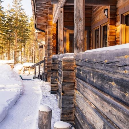 Finnish wooden log house winter time, Råmossa Lodge