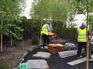 The hut from  Stuart Garden Architecture  arrives and begins to be installed
