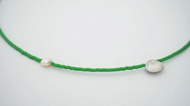 New necklace. Tiny silver shell and a single pearl, along with green miyuki beads.