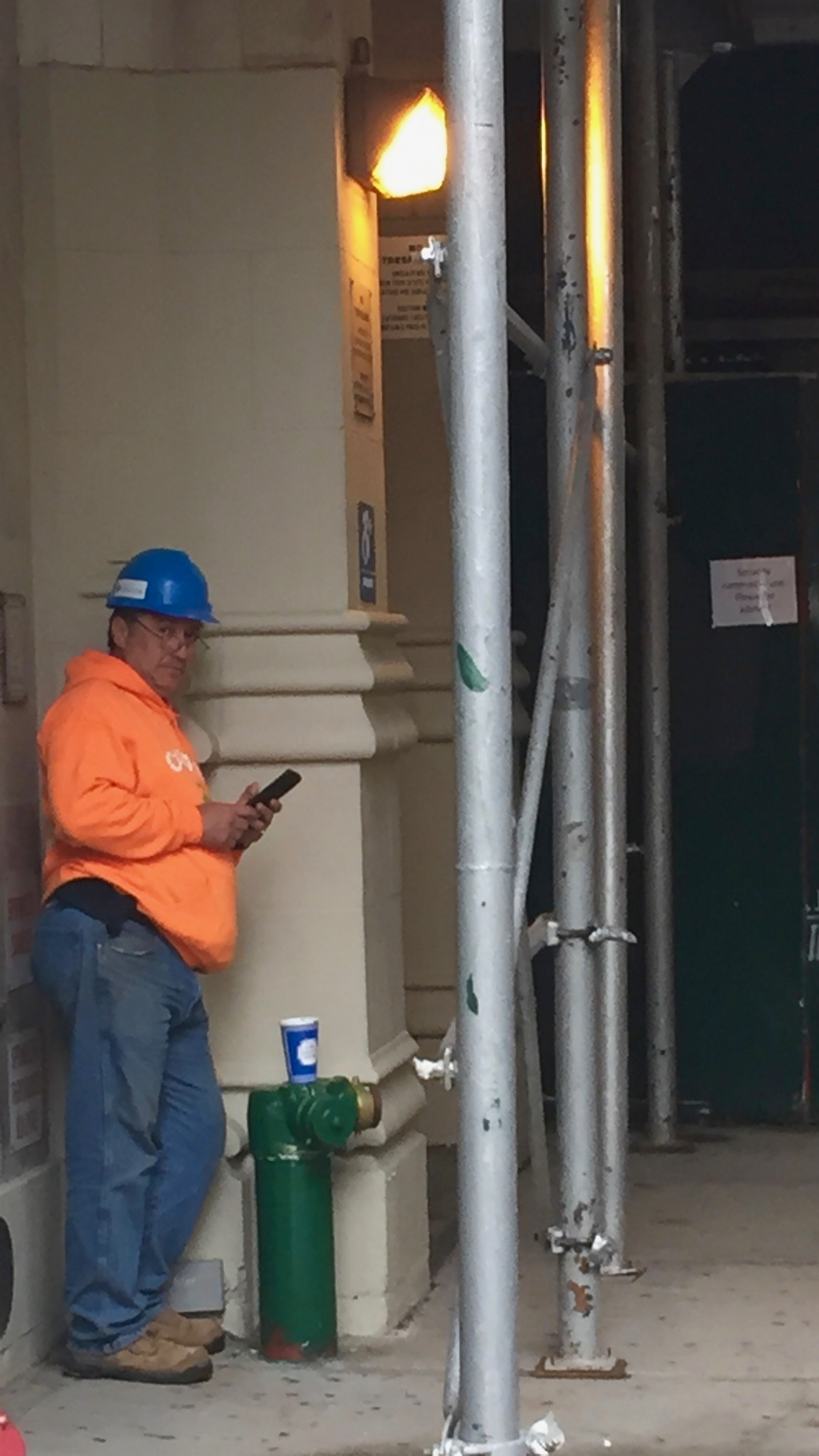 A Construction Foreman in the West Village checks on suppliers