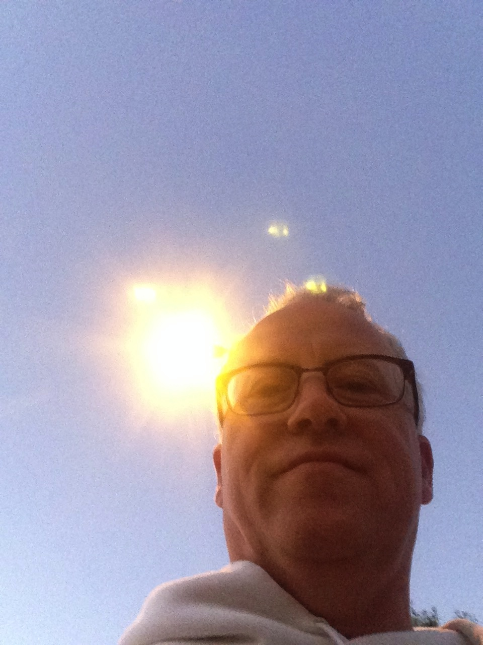 The the tapered, white cement lamp post is behind my head.