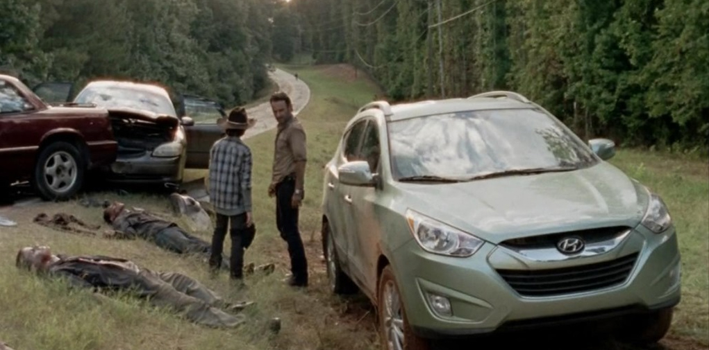 "A typically heartwarming moment shared between father and son, together with slain zombies and the trusty Hyundai Tucson, on ""The Walking Dead"""