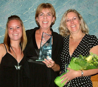 Accepting for Schendel & Sullivan are staff (from left to right) Meagan Shular, Cheri  Duhaim & Patty Campbell