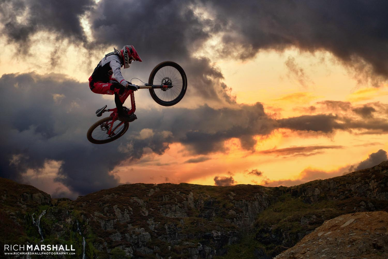 A different more dramatic sky with ground and mountain biker further darkened to add realism.