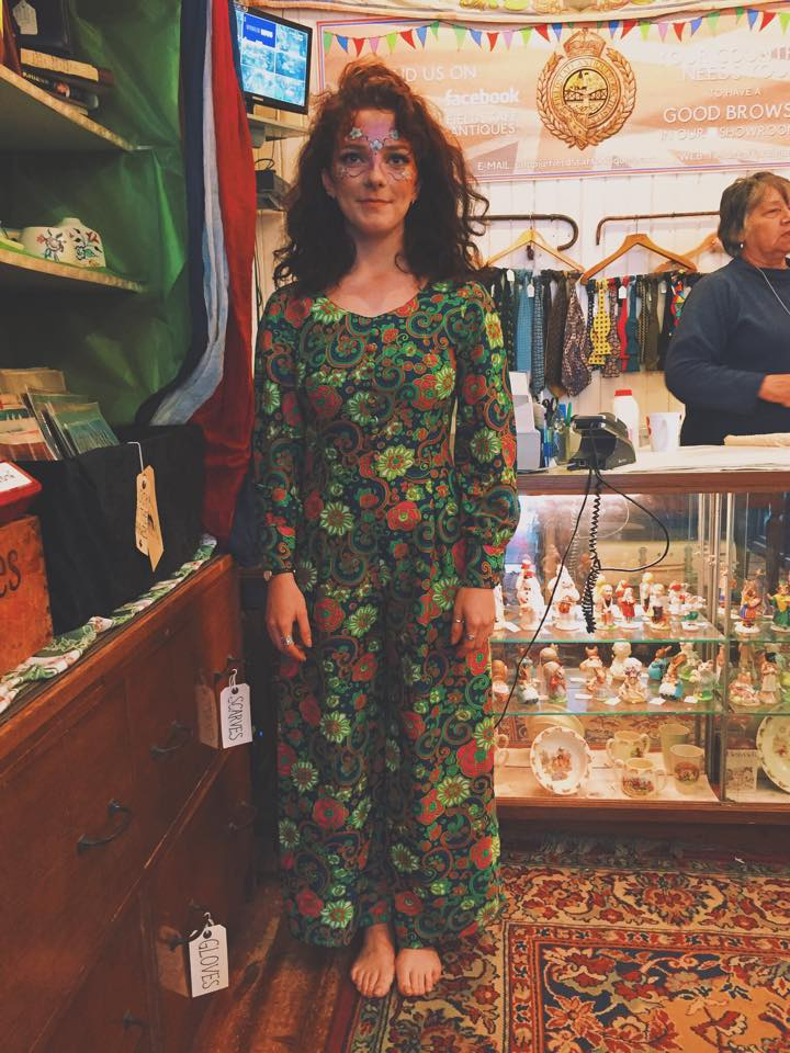 Stunning customer in our 1960's pant-suit...great facepainting too!