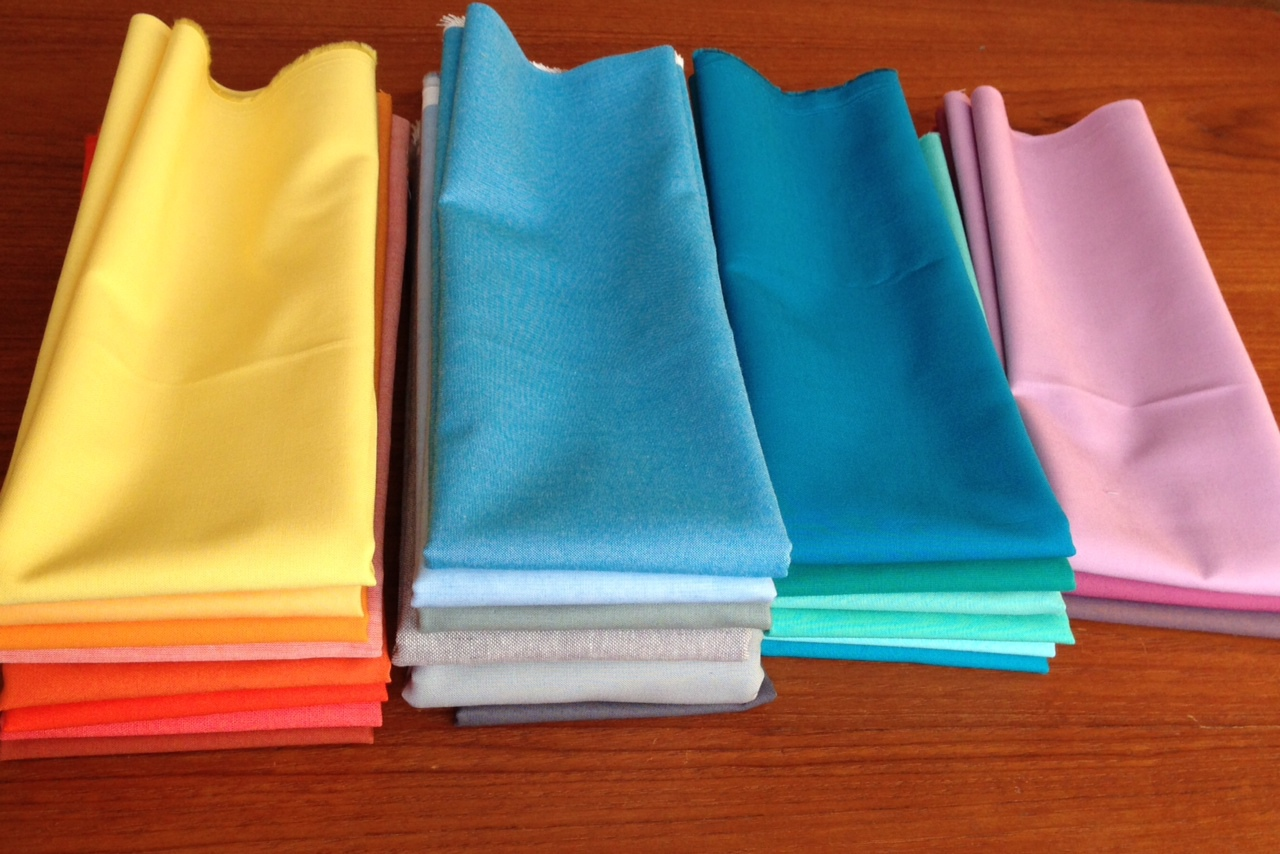 Lots of wonderful new fat quarters and yards of new solids (Dec 2013)