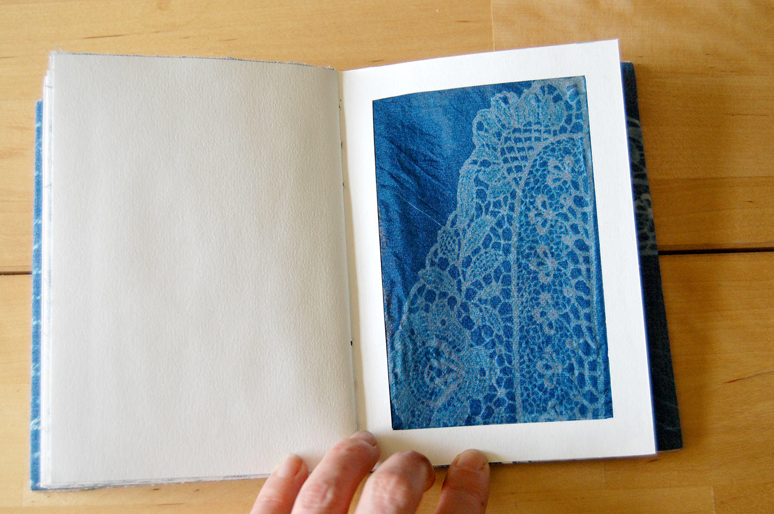 cyanotype of victorian lace on silk.