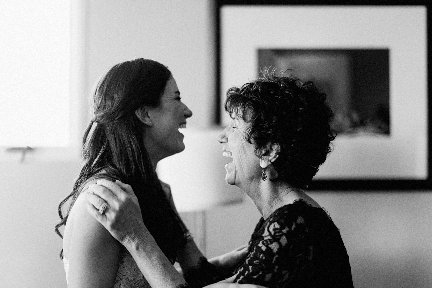 mom and daughter laughing best of wedding photographer