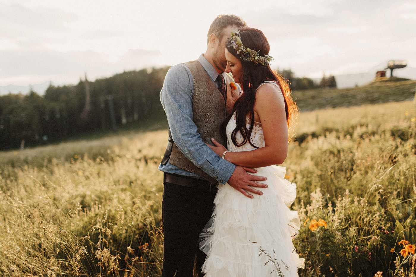 intimate candid moment bride and groom crested butte meadow wild